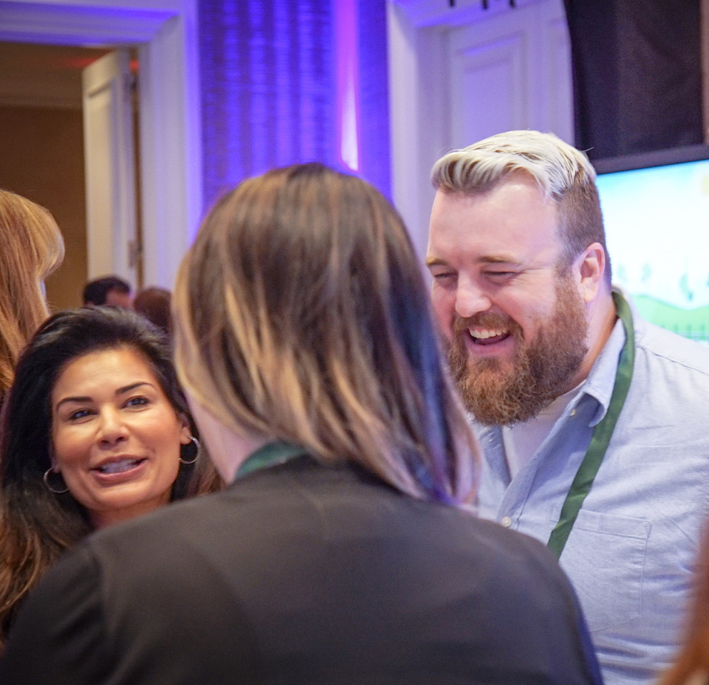 Amazon.com's Justin Boettcher fielding inquiries from Aneela Zaman of Zaman skincare and other attendees at the BeautyX Retail Summit in Dallas, TX.