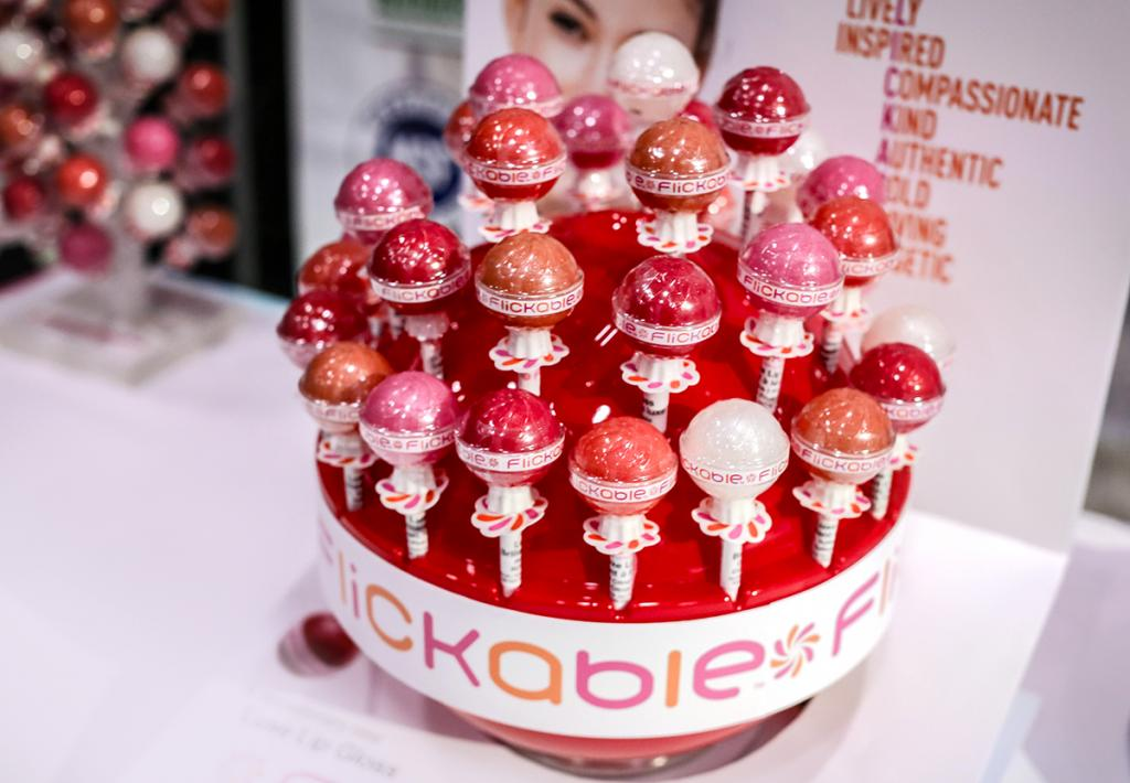 For a lip gloss to stand out in the trending tween and teen market, appealing and innovative packaging, such as Flickable's lollipop style flavored lip balm, is the way to go. (IBE NY 2018 Biggest Beauty Trends)