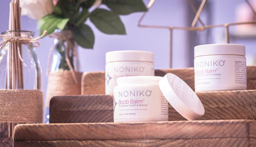 Noniko's Boob Balm serves a dual purpose. It moisturizes oft-neglected chest skin while introducing a routine that makes critical self-breast checks a daily occurence. (IBE NY 2018 Biggest Beauty Trends)